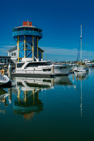 The Mooloolaba Wharf is a place for boats to moor and people to visit restaurants and shops. Here it looks very colourful on a bright summer day. Stock fotó