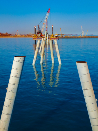 The construction of a wharf in full flow with raked piles in place ready for headstocks