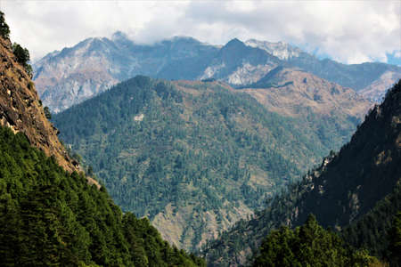Mountain ranges of Himalayas captured when hikking to Chhalal from Kasol, Himachal Pradesh, India. Amazing view. Stock Photo