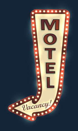 Glowing motel sign with light bulbs.