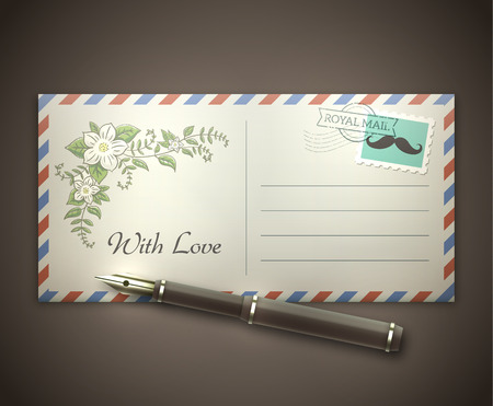 postal stamp: Old style blank envelope with a picture of flowers and a postal stamp lying on a desk with a vintage pen.