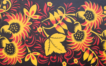graffiti art: Graffiti art on street wall. Flowers and Leafs - yellow and red colors. Stock Photo