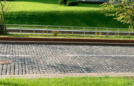 stone road: Paving stone road Green grass and sidewalk