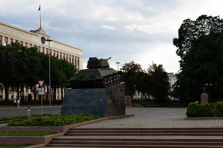 t34: Tank monument in center of Minsk city. Green grass and trees Editorial