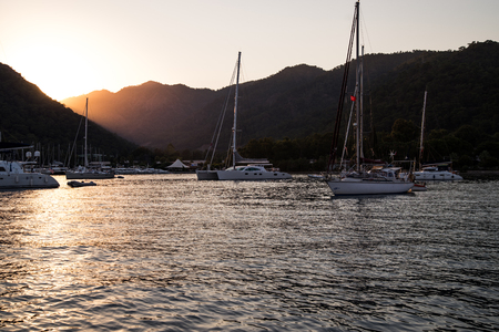 Yachts in bay with evening light. Mediterranean sea and calm weather