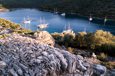 Yachts in bay with morning light. Mediterranean sea and calm weather