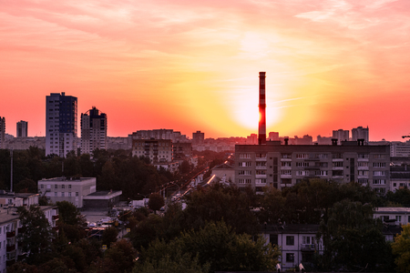 quite: Sunrise over shabby district of Minsk city. Bright sky and red colors of nature