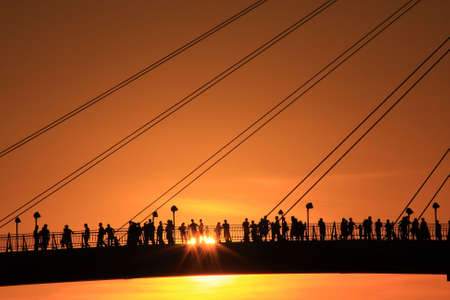 people appreciates the sunset on the bridge Stock Photo - 5258226