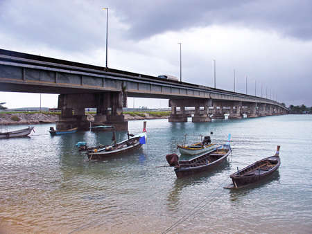 Sarasin Bridge and fisherman s boats, Phuket, Thailand     photo