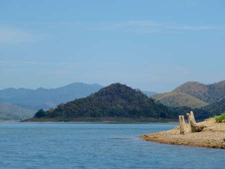 Lagoon timber and mountain Reklamní fotografie