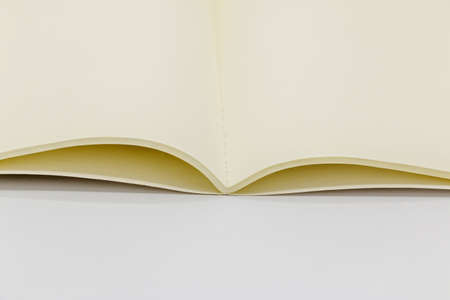 Close-up open notebook on white background Stock Photo