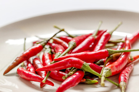 Red chili pepper on dish background