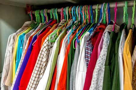 Colorful men clothing hanging in closet Reklamní fotografie
