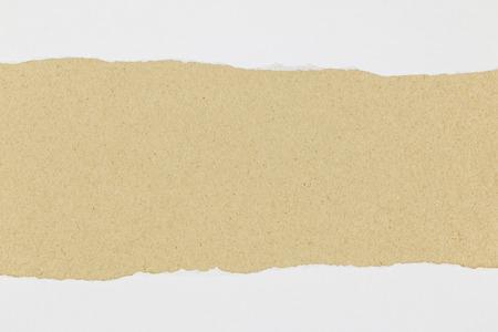 White paper torn on brown background Reklamní fotografie