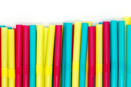 Colorful straws pipe on white background