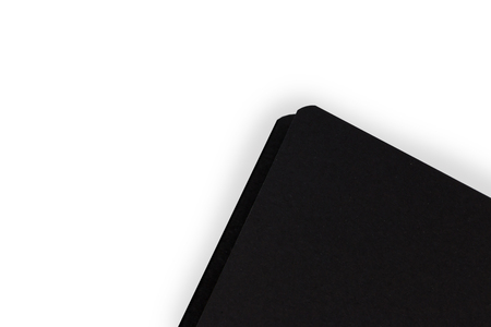 Closeup black color notebook on white background