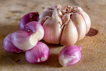 Red onions and garlic vegetable on wood background