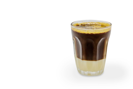 Black coffee and milk in a glass on white background Reklamní fotografie