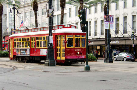 canal street: New Orleans, USA - July 8, 2015: A Canal Street line streetcar rides in the downtown of New Orleans, Louisiana.