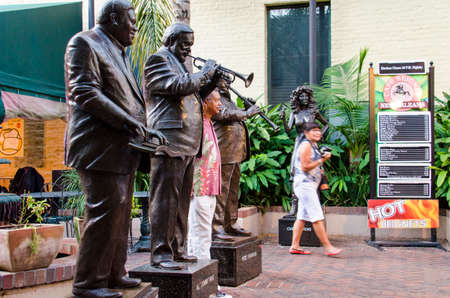 pete: New Orleans, USA - July 8, 2015: Statues of famous jazz music players, the three Greats, Antoine Fats Domino, Al Jumbo Hirt and Pete Fountain on Bourbon Street, French Quarter. Editorial