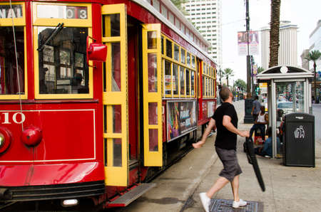 canal street: New Orleans, USA - July 8, 2015: People get off from a Canal Street line streetcar in the downtown of New Orleans, Louisiana.