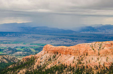 cloudy moody: Hoodoos during cloudy, moody weather at Bryce Canyon National Park in Utah Stock Photo