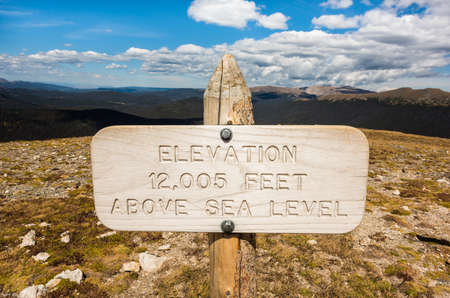 rocky mountain national park: A wooden, elevation above sea level sign in Rocky Mountain National Park, Colorado