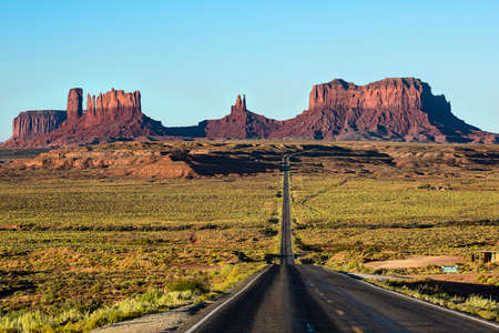 monument valley view: View of Monument Valley canyons during sunrise with Road in Arizona