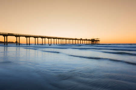wide  wet: Wide angle shot of Scripps Pier with reflection during sunset in La Jolla, San Diego, California