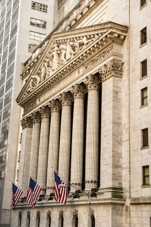federal hall: New York, USA - June 18, 2016: Vertical view of the New York Stock Exchange with American flags
