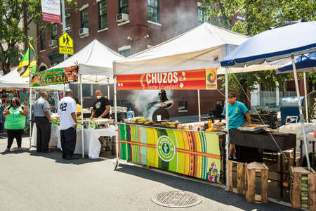 jamaican food: New York, USA - June 18, 2016: Street market in New York City with Chuzos Ecuadorian and Jamaican food stands Editorial