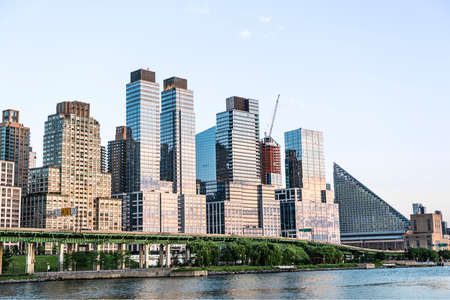 riverfront: New York, USA - June 18, 2016: Skyline of Trump skyscrapers and FDR highway in Riverfront park in New York City