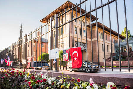 bombings: Washington D.C., USA - June 29, 2016: Flowers and posters at Turkish Embassy to honor lives lost in Istanbul bombings of June 28, 2016