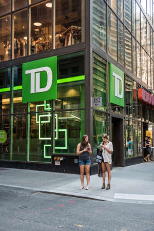 bank branch: New York, USA - June 18, 2016: TD Bank branch by broadway street in NYC with two young women on smartphones Editorial