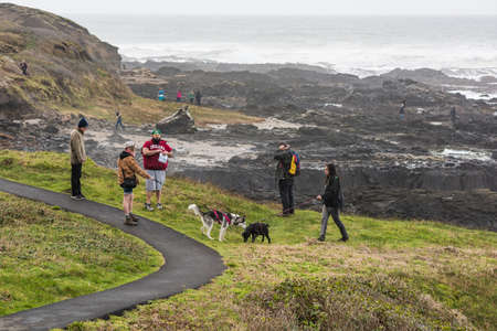 thor's: Yachats, USA - Februrary 27, 2016: Hikers with dogs near Thors well in Cape Perpetua in Oregon Editorial