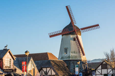 santas village: Solvang, USA - February 13, 2016: Danish windmill houses in a tourist town in California