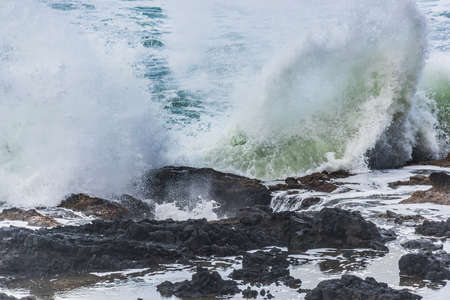 thor's: Thors well water splashing against tide pool in Cape Perpetua in Yachats Oregon