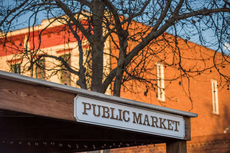 public market sign: Public Market sign on western building with bare tree Stock Photo