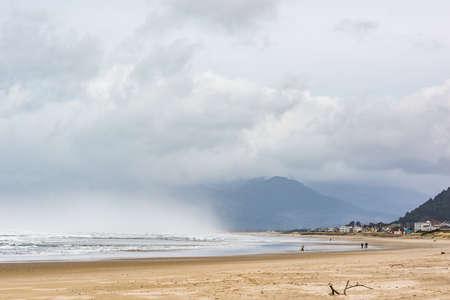 beach rain: Stormy clouds and rain at Pacific ocean in Rockaway Beach, Oregon Stock Photo