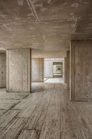 passageway: La Jolla, USA - December 10, 2015: Cement modern urban architecture of the Salk Institute in San Diego with dark passageway tunnel Editorial