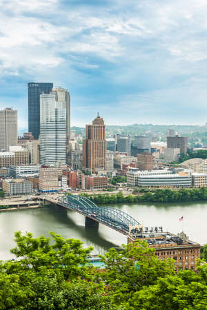allegheny: Pittsburgh, USA - June 3, 2016: Vertical view of city cityscape or skyline with dark storm clouds, Smithfield street bridge and Monongahela river