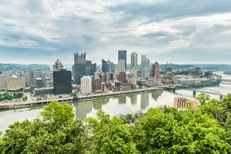 allegheny: Pittsburgh, USA - June 3, 2016: Cityscape or skyline on the city from Washington Park with storm clouds Editorial