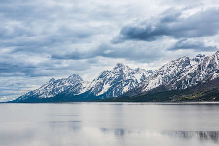 oxbow: Grand Teton mountains with lake and dark, stormy cloudy, overcast, sky in national park Stock Photo