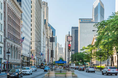 prudential: Chicago, USA - May 30, 2016: Divided street with traffic on South Michigan Avenue in downtown with cars and skyscrapers