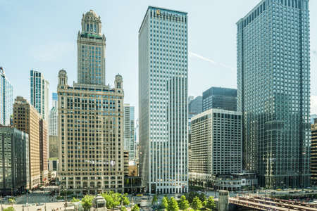 magnificent mile: Chicago, USA - May 30, 2016: View of Wacker Drive with bridge, skyscrapers, people and cars in downtown Editorial