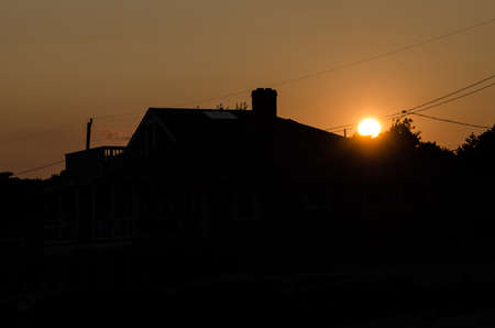 suburban: Sunset with silhouette of residential suburban home