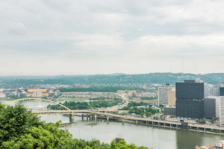 allegheny: Pittsburgh, USA - June 3, 2016: Cityscape or skyline view of Allegheny and Ohio rivers and Heinz field with bridge