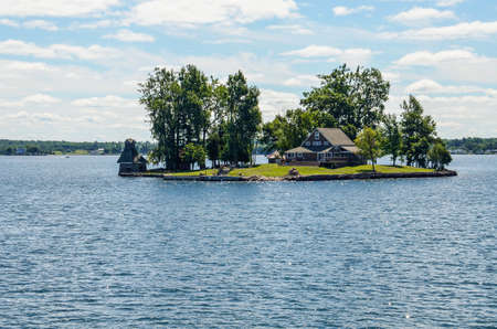 kingston: Kingston, Canada - July 24, 2014: Saint Lawrence river in the Thousand Islands on the Canadian side of the archipelago