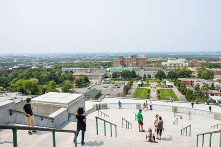 oratoria: Montreal, Canada - July 25, 2014: Saint Josephs Oratory of Mount Royal with steps and people