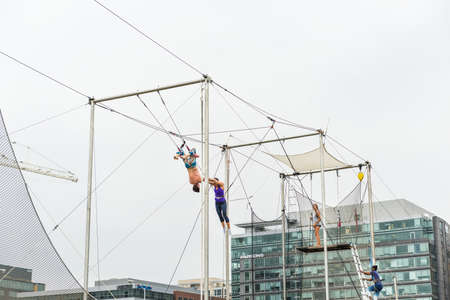 trapeze: Washington DC, USA - September 24, 2016: Trapeze artists training outside in park Editorial